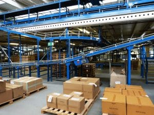 warehouse setup including pallet racks and conveyors